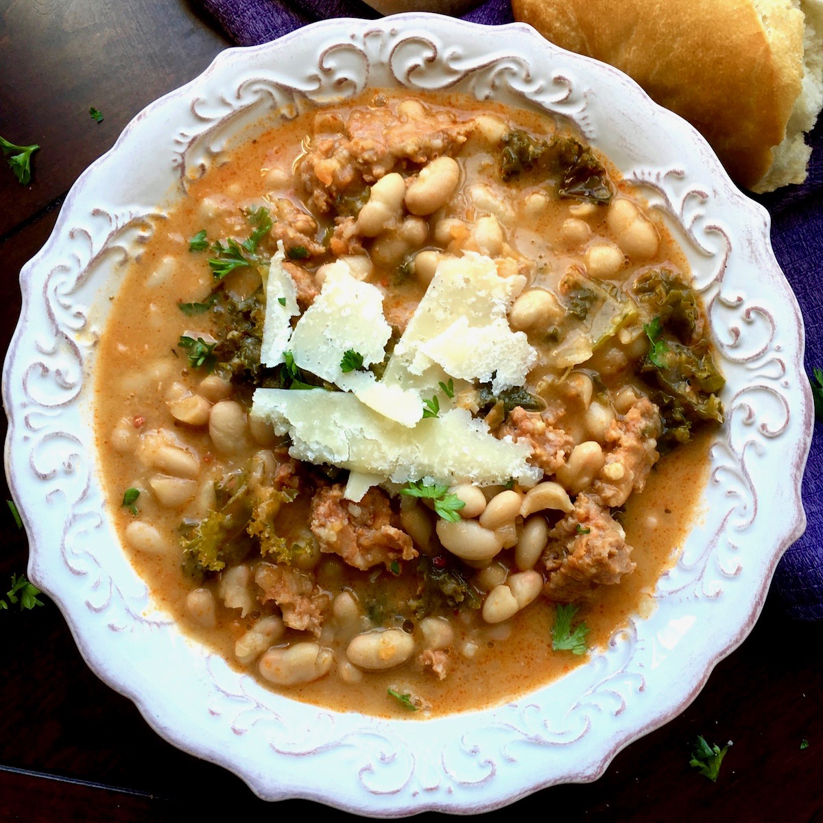 This delicious Dutch Oven White Bean, Spicy Sausage and Kale Soup is pure comfort food for the fall and winter seasons.