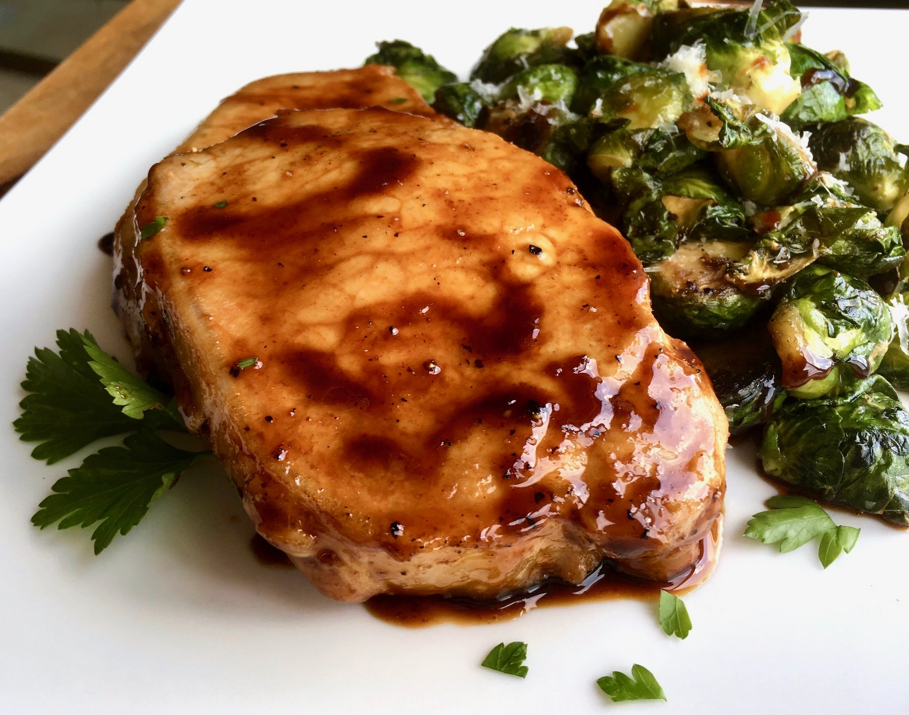 Have this easy skillet Pork Chops with Maple Balsamic Reduction on the table in under 30 minutes. Perfect for a weeknight meal, this simple skillet dinner of Pork Chops with Maple Balsamic Reduction will quickly become a family favorite.