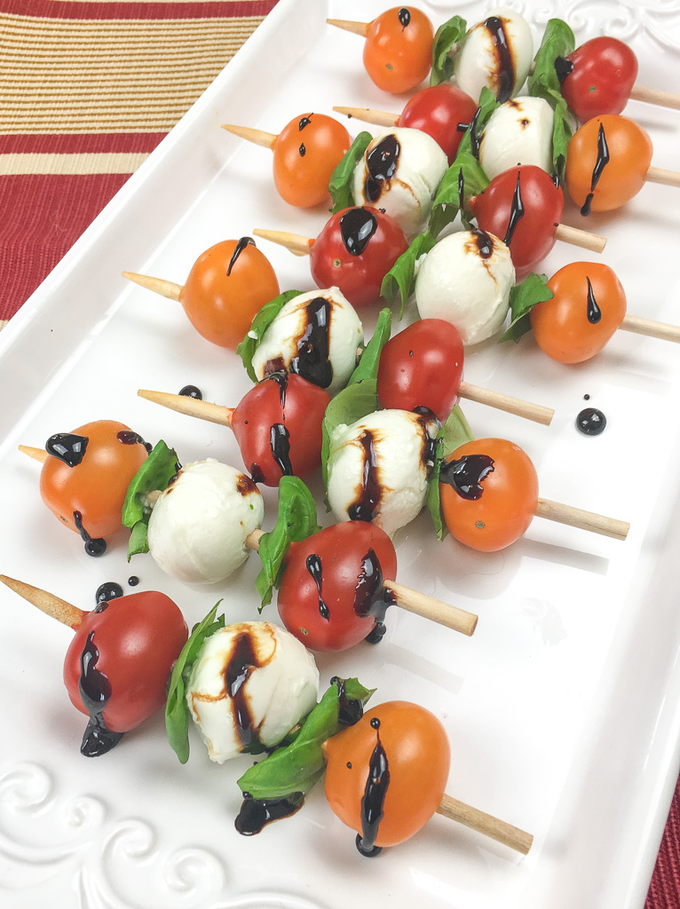 This quick and easy appetizer is sure to be a hit at your next party. Traditional elements of a Caprese salad, tomato, basil and mozzarella are arranged on a short skewer for an instant and savory appetizer.