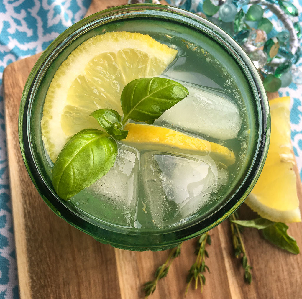 This refreshing spritzer is full of fantastic flavors, including lemon, fresh herbs, and ginger. It's bright fruity flavor pairs perfectly with the warm earthiness of the culinary herbs and freshly grated ginger for a truly interesting combination. One taste and this is sure to become a new warm weather favorite!