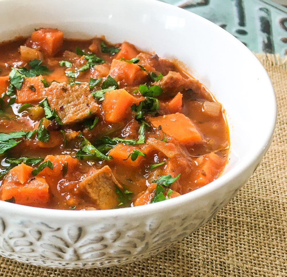 This quick and flavorful one pot Dutch Oven Pork Tenderloin And Sweet Potato Stew is super easy to put together on a busy weeknight.